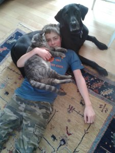 Petkid with his dog and one of his cats